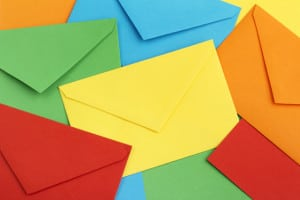 An array of bright and colorful envelopes in five colors
